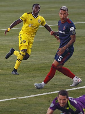 Columbus Crew SC midfielder Derrick Etienne (22) scores against Chicago Fire during the first half at MAPFRE Stadium in Columbus, Ohio on Aug. 20, 2020. The game was held without any fans in the stadium.