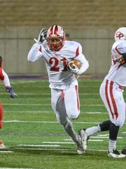 St. Philip running back Brayden Darr rushes in the MHSAA 8-Player Division State Final at Greenville.