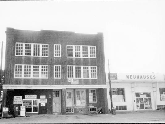 The Arthur Hufnagel Public Library, right, is shown in its original state as one of two buildings operated by the Neuhaus brothers.