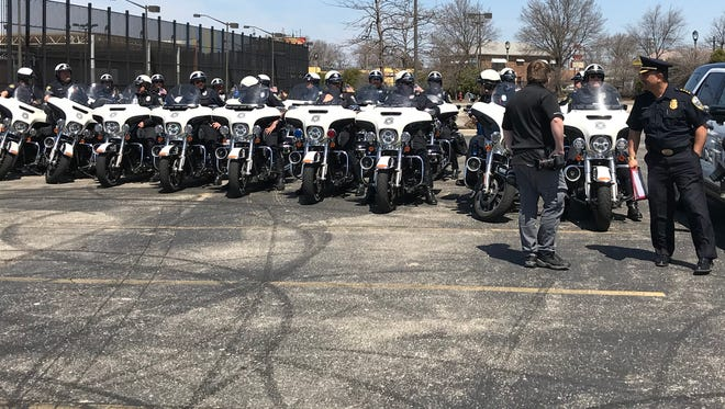 Milwaukee Police Chief Alfonso Morales talks to his department's motorcycle officers before announcing a new traffic initiative on April 30, 2018.