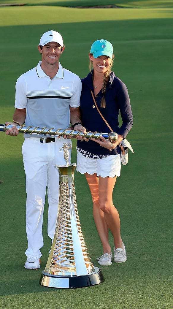 Rory McIlroy poses with his girlfriend Erica Stoll