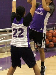 Katelyn Yuzos, right, puts up a shot while being defended by teammate Justice Blake on Wednesday afternoon.