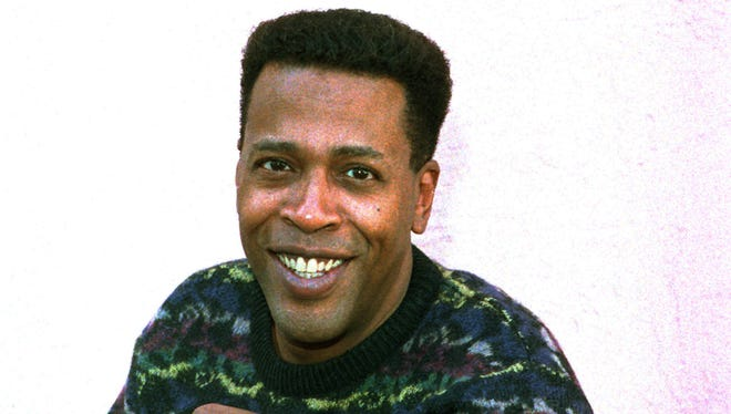 """In this Jan. 30, 1989 file photo, actor Meshach Taylor poses during an interview in Los Angeles, Calif. Taylor's agent says the actor, who appeared in the hit sitcoms """"Designing Women"""" and """"Dave's World"""" died of cancer on Saturday, June 28, 2014, at his home in Los Angeles. He was 67.  (AP Photo/Nick Ut, File)"""