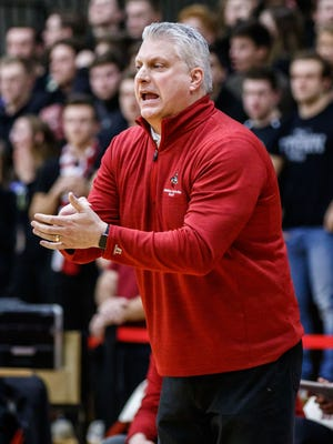 Waukesha South girls basketball coach Paul Darling cheers on his team during the WIAA Division 1 regional championship game against Germantown on Feb. 24. Darling, the coach of the Blackshirts for 20 years, recently announced he is stepping down from his post.