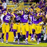 LSU Tigers linebacker Deion Jones (45) celebrates with teammates following an interception against the Eastern Michigan Eagles during the second half of a game at Tiger Stadium. LSU defeated Eastern Michigan 44-22.