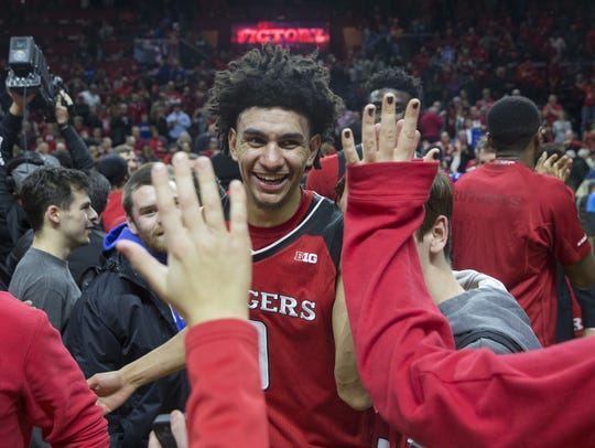 Rutgers' Geo Baker celebrates with fans after beating Seton Hall in 2017.