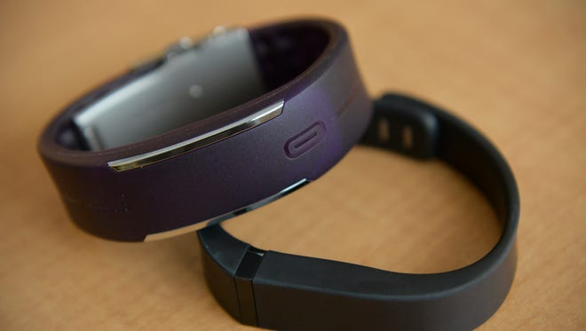 The Polar Loop and the Fitbit are two examples of wearable activity trackers. They can keep track of exercise, water and food intake, sleep amount and quality, and other data to help their users monitor and improve their health.