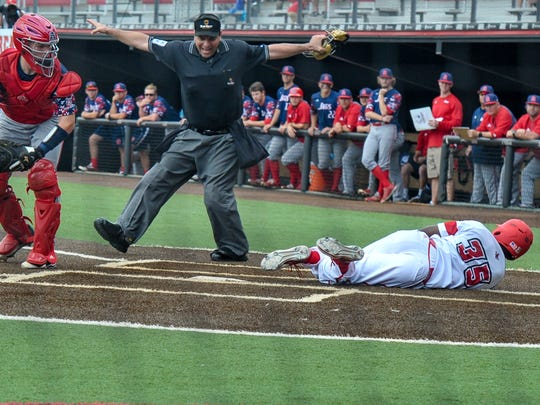 Home plate umpire Olindo Mattia calls Ishmael Edwards safe at home on his inside-the-park home run in UL's win over South Alabama on Sunday.
