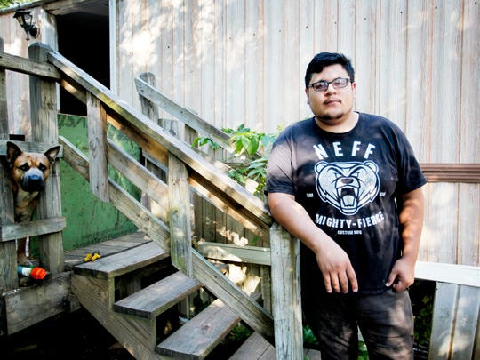 Uriel Ramerez stands outside his home at Lakeview Mobile Home Park Thursday.
