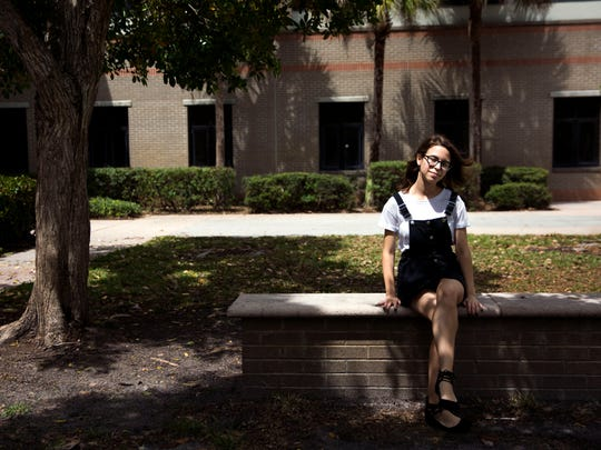 Pilar Forrest, a senior at Lely High School, sits at