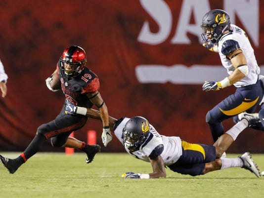 San Diego State running back Donnel Pumphrey breaks the tackle of California's Darius Allensworth for a 41-yard run during the second half of an NCAA college football game Saturday, Sept. 10, 2016, in San Diego. (AP Photo/Don Boomer)