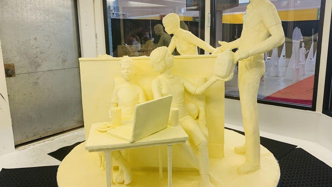 "The 52nd annual butter sculpture at the New York State Fair was unveiled Tuesday. Approximately 800 pounds of butter was used to create the sculpture. This year's theme is ""Nourishing Our Future."""
