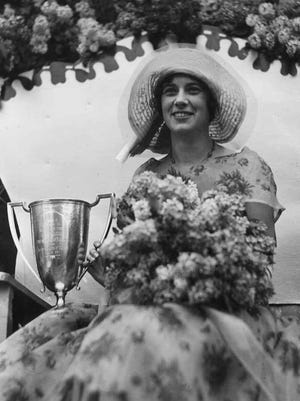 -  -Albert Stone photograph of Christina M. Blackwell, Lilac Queen, during Rochester's Lilac Festival. Photo originially printed in the Democrat & Chronicle May 19, 1930. MANDATORY CREDIT: The Stone Collection, Rochester Museum and Science Center.
