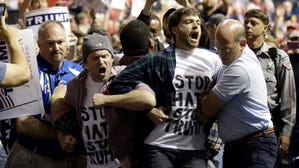 Protesters are removed as Donald Trump speaks during a campaign rally in Fayetteville, N.C., on March 9.