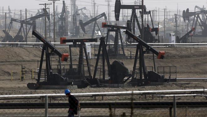 FILE – This Jan. 16, 2015 file photo shows pumpjacks operating at the Kern River Oil Field in Bakersfield, Calif. The price of oil topped $50 a barrel this week for the first time since July, delivering a cash infusion to oil producers and a lift to beaten-down energy stocks.