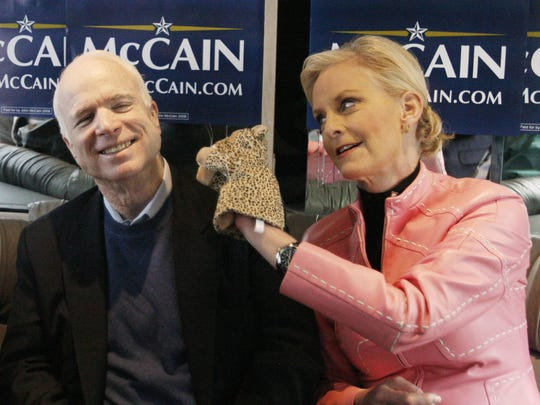 "Cindy McCain, wife of Republican presidential hopeful Sen. John McCain, R-Ariz., uses a cheetah hand puppet to make her husband laugh as they ride the ""Straight Talk Express"" campaign bus to a polling station on the day of South Carolina's Republican presidential primary in Charleston, South Carolina, on Jan. 19, 2008."