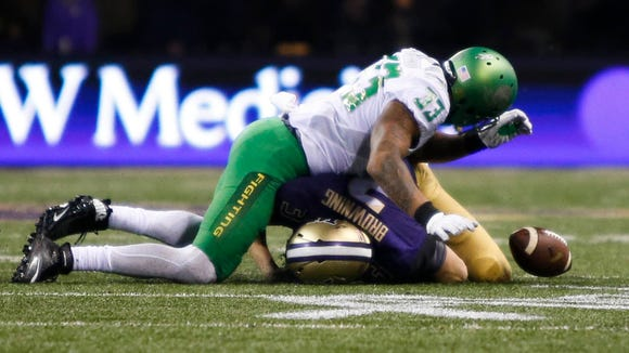 Oct 17, 2015; Seattle, WA, USA; Washington Huskies quarterback Jake Browning (3) fumbles after being tackled by Oregon Ducks linebacker Tyson Coleman (33) during the fourth quarter at Husky Stadium. Oregon defeated Washington, 26-20. Mandatory Credit: Jennifer Buchanan-USA TODAY Sports