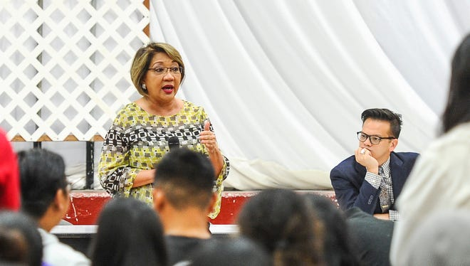 Sen. Nerissa Bretania Underwood replies to a student's question during a question and answer session at the Simon Sanchez High School in Yigo on Friday, April 1. The senator was on hand to entertain inquiries on Bill 279-33 from the school's Government class students.
