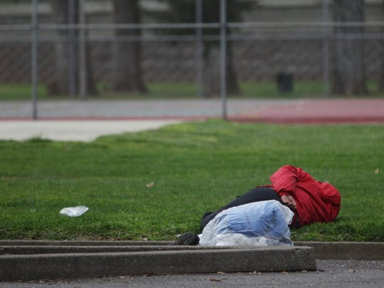 Andreas Fuhrmann/Record Searchlight A person sleeps in South City Park Wednesday afternoon.
