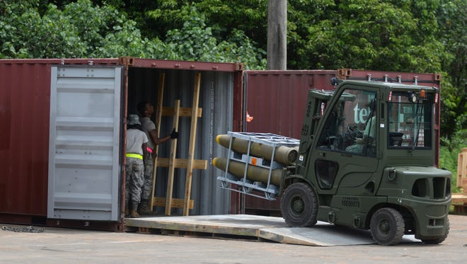 U.S. Air Force assigned to the 36th Munitions Squadron unload munitions shipping containers Sept. 7, 2017, at Andersen Air Force Base, Guam. This shipment will restock expired munitions as well as supports an overall growth of more than 10 percent of total munitions on hand on Guam.