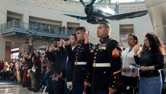 Marines naturalized as U.S. citizens in Triangle, Va., in 2014.
