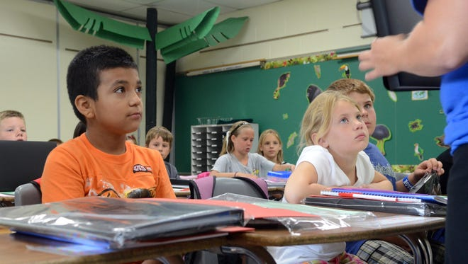 Students listen to their fourth grade teacher Kristen Wasalski at Croswell-Lexington Middle School.