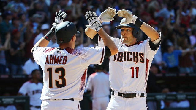 Arizona Diamondbacks' Nick Ahmed (13) greets A.J. Pollock (11) following his two run home-run in the 6th inning of their opening day MLB game against the San Francisco Giants Sunday, April 2, 2017 in Phoenix, Ariz.