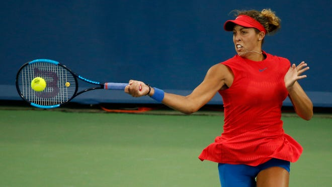 Madison Keys returns a shot in the first set of the match between CoCo Vandeweghe (USA) and Madison Keys (USA) during the Western & Southern Open at the Lindner Family Tennis Center in Mason, Ohio, on Monday, Aug. 14, 2017. Keys took the first set, 6-4.