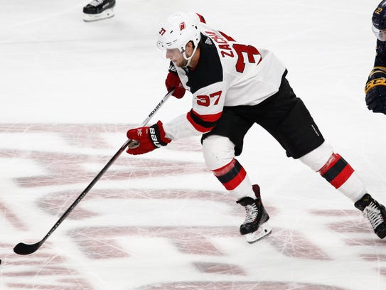 New Jersey Devils forward Pavel Zacha (37) skates up