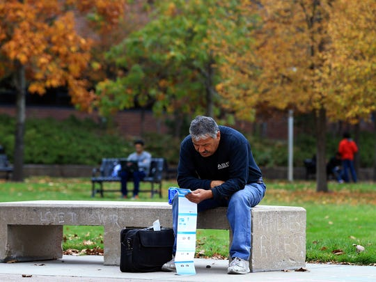 Billy Gallegos reviews a pamphlet with information on local and national candidates before the 2016 general election. Volunteers handed out the election material on Oct. 25, 2016, at the University of Colorado-Denver in Denver, Colorado.