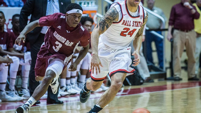 Ball State's Jeremiah Davis slips past Alabama A&M's defense during their game at Worthen Arena Tuesday, Dec. 29, 2015.