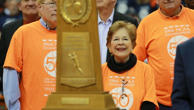 Mary Haskins, widow of longtime UTEP head coach Don Haskins, smiles as she and her sons are introduced at a halftime ceremony Saturday at the Don Haskins Center. Brent Haskins is at left and Steve Haskins is at right.