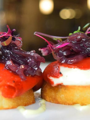 Piquillo peppers are stuffed with truffle-honey goat cheese. Costa Blanca also features a selection of fine Spanish, Argentinian and domestic wines.
