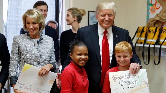 President Trump and Education Secretary Betsy DeVos in Orlando on March 3, 2017.