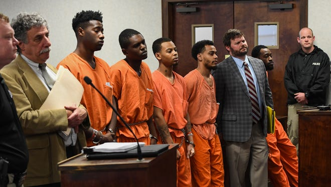 Suspects in orange, from left to right: Jaquin Dodd, Curtis Lee Collin, Damous Chavon Beasley, Xavier Miguel Concepcion and Justin Dashun Miller