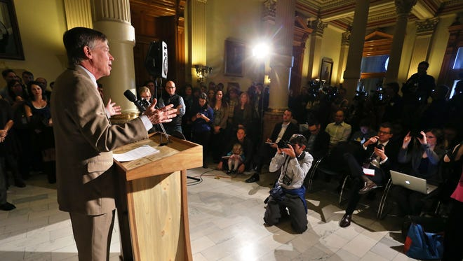 Newly re-elected Colorado Gov. John Hickenlooper delivers his victory speech to supporters and staff at the Capitol in Denver, Wednesday, Nov. 5, 2014.