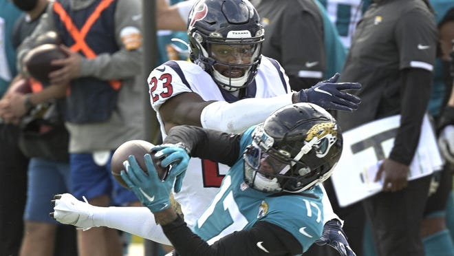 Houston Texans safety Eric Murray tries to break up a pass reception by Jacksonville Jaguars wide receiver DJ Chark Jr. during Houston's 27-25 win Sunday in Jacksonville, Fla.