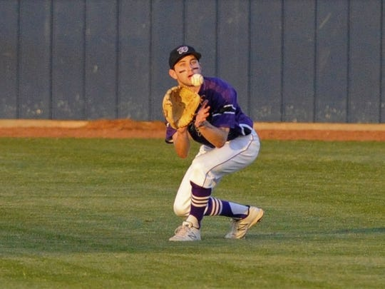Wylie center fielder Sam King (33) looks in a line drive during the Bulldogs' 1-0 loss to Graham in Game 1 of the Region I-4A bi-district series.