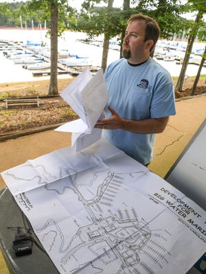 Bryan Boggs of Big Water Marina looks over plans for renovations at Big Water Marina in Starr on Thursday.