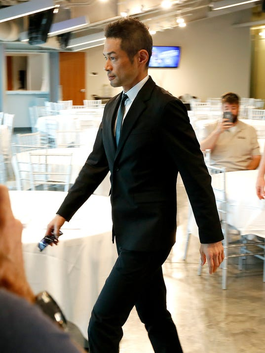 Seattle Mariners' Ichiro Suzuki arrives at a news conference at the teams' spring training baseball complex Wednesday, March 7, 2018, in Peoria, Ariz. Suzuki signed a one year deal in his return to the Mariners. (AP Photo/Matt York)