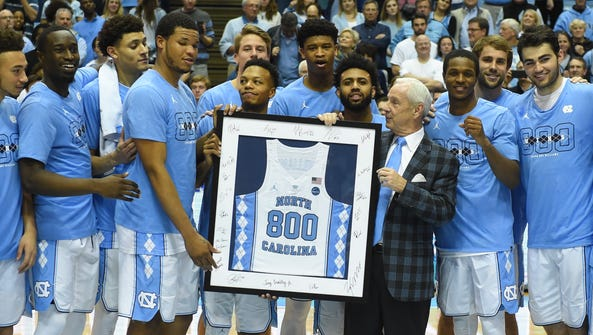 Roy Williams became the ninth Division I coach to reach