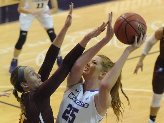 ACU's Lexi Kirgan (25) shoots over Midwestern State's