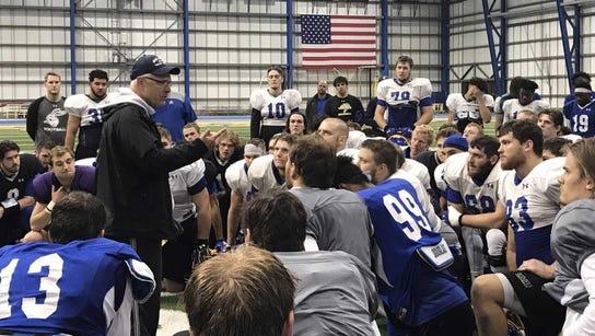 John Stiegelmeier talks with his team after a practice
