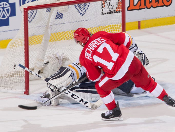 Detroit Red Wings  center Brad Richards sends the puck