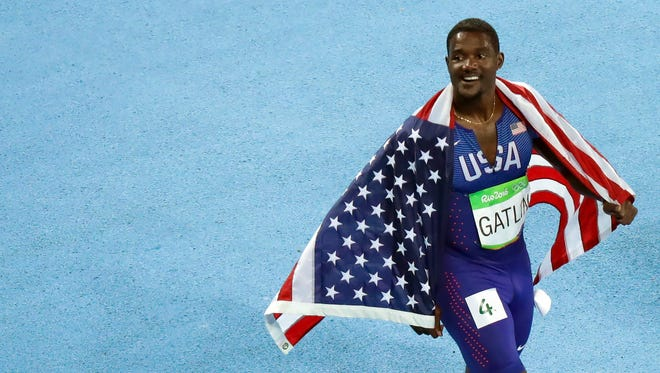 Justin Gatlin (USA) reacts after the men's 100 final during track and field competition in the Rio 2016 Summer Olympic Games at Estadio Olimpico Joao Havelange.