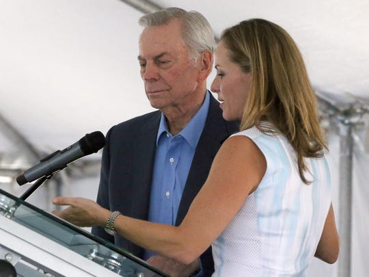 El Paso businessman Jack Cardwell and Emma Schwartz, president of the Medical Center of the Americas Foundation, take part in Friday's grand-opening ceremony for the Cardwell Collaborative biomedical research building at 5130 Gateway Blvd. East in Central El Paso. The building bears Cardwell's name because he made a substantial donation to help pay for its construction.
