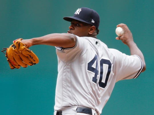 New York Yankees' Luis Severino delivers against the Cleveland Indians during the first inning in a baseball game, Sunday, Aug. 6, 2017, in Cleveland. (AP Photo/Ron Schwane)