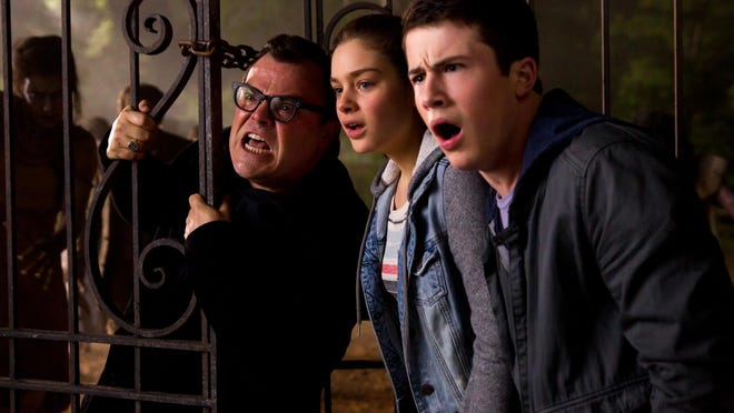 """Jack Black, from left, Odeya Rush and Dylan Minnette star in """"Goosebumps,"""" which pay tribute to the fans of the kid's series."""