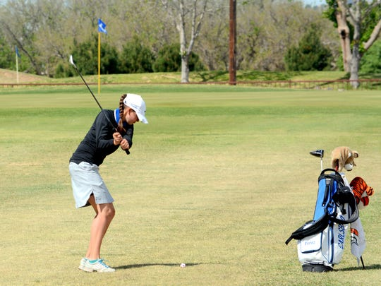 Carlsbad's Nicole Florez swings on the 18th green Tuesday