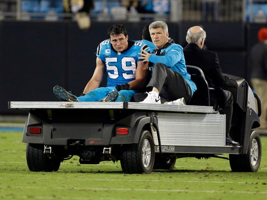 Carolina Panthers linebacker Luke Kuechly (59) is taken